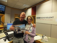 Julian Clegg and Pauline Rowson with picture of Julian reading Silent Running, crime novel on holiday