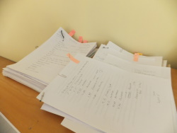 Neat piles of crime writing in progress