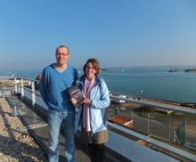 Pauline Rowson and Gordon Watson on the roof of IMS with Langstone Harbour in the background