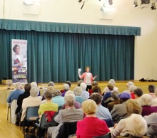 Pauline Rowson entertaining a packed U3A Meeting