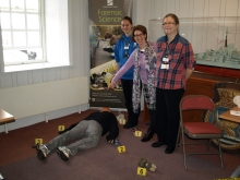 Sam Day, Helen Gittins South Downs College Forensic Science Dept. with crime author Pauline Rowson centre and Victor, the body