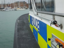 Heading across to Royal Clarence Marina on the police launch