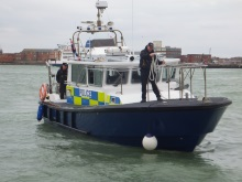 Police launch heading into Gunwharf Quays