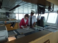 Pauline Rowson signing for Captain Paul Marshall on Wightlink Ferry