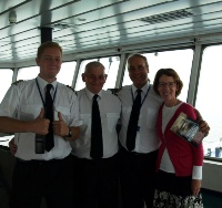 Pauline Rowson with Captain, Chief and Loadmaster on Wightlink ferryifaatain