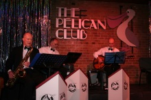 The band at the Pelican Club before the murder takes place
