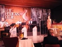 The musicians entertain the audience at the Pelican Club - Act One Dramacican