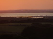 Sunset over Newtown Harbour Isle of Wight, featured in Silent Running by Pauline Rowson